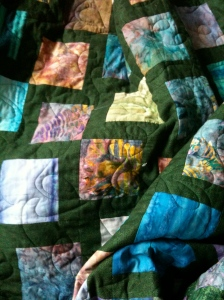Mum's green bali batik quilt