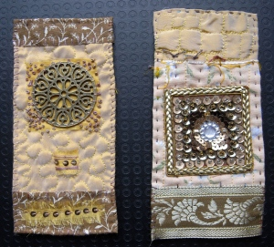 Two golden Laura Ashley mini quilts