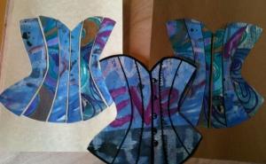 Three paper corsets
