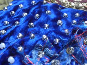Anchoring the silk velvet with glass beads