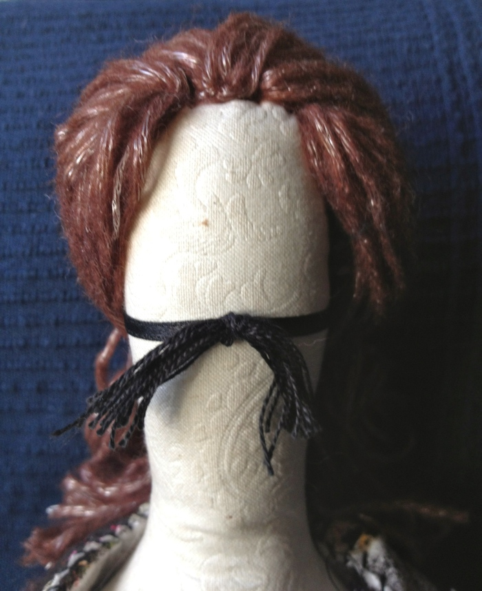 Doll with false moustache
