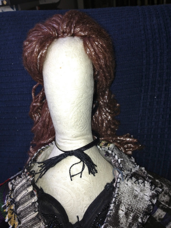 Doll wearing false moustache as a choker